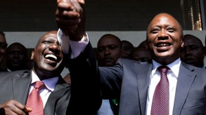 President-elect Kenyatta greets his supporters with his running mate Ruto after attending a news conference in Nairobi
